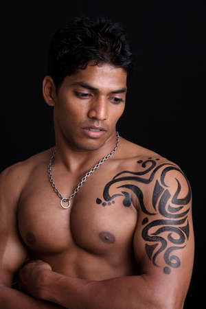Indian young body builder posing to the camera   photo