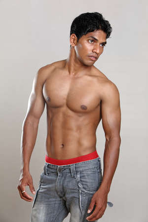 asian abs: Indian young body builder posing to the camera