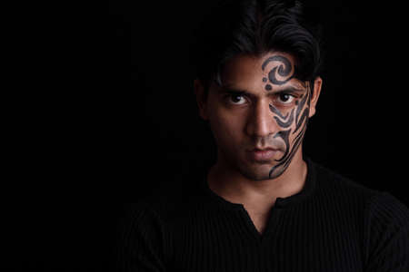 Indian young man portrait with face painting   photo