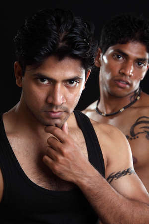 Fitness Indian people on black background  photo