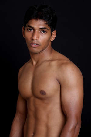 Indian young fitness man on black  photo