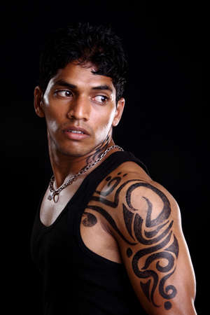 indian tattoo: Indian young man posing to the camera