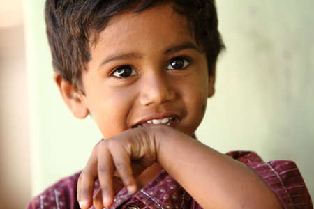 innocence: Cute Indian little boy looking at the camera   Stock Photo
