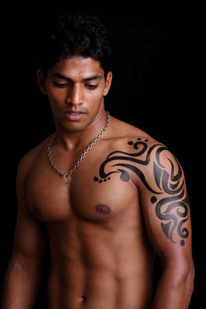 muscular male: Indian young body builder posing to the camera