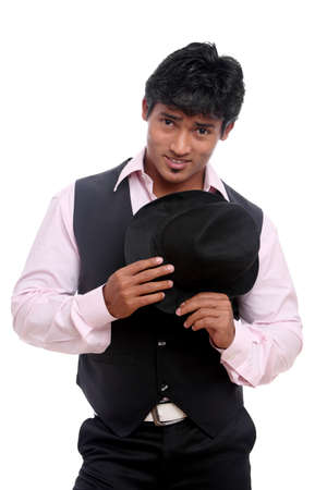 Indian young businessman posing with hat isolated on white. Stock Photo - 12361795