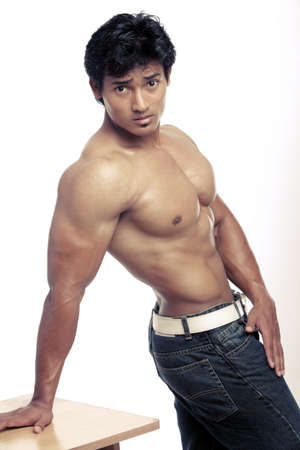 asian abs: Indian young fitness man posing to the camera.  Stock Photo