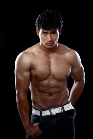 Indian young fitness man posing to the camera.  photo