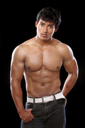 male torso: Indian young fitness man posing to the camera.  Stock Photo