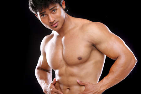 Indian young fitness man posing to the camera.  Stock Photo - 12367671