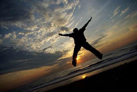 taken: Man jump with full of enjoy taken with sunset background