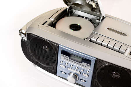 portable rom: One grey tape recorder on white