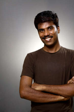 male  man: Indian young man posing to the camera