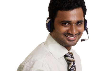 Indian young working in call center on white background   Stock Photo - 12361658
