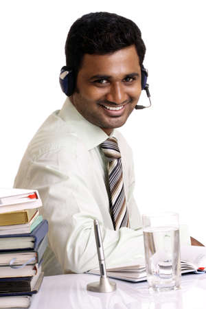Indian young working in call center on white background   photo