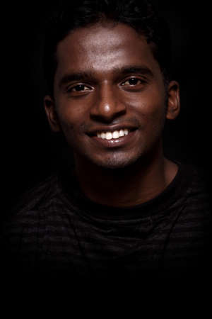 Indian young man on black background  photo