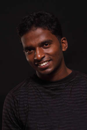Indian young man on black background Stock Photo - 12361743