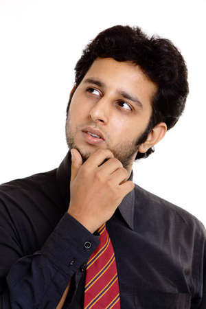 Angry Indian young businessman starring at side  photo
