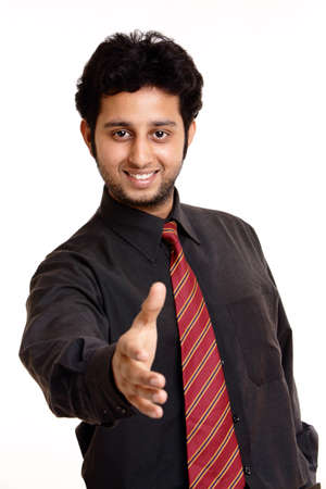 welcoming: Indian young businessman posing isolated on white