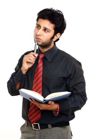 Thinking Indian young businessman photo