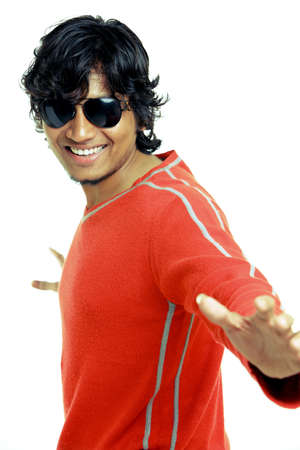 Indian young man posing with expression on white