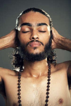 Indian young sadhu posing to the camera   photo