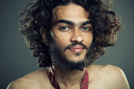 Indian young man posing to the camera   photo
