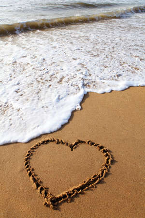 heart in sand: Heart scratched into a empty beach, India