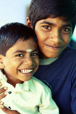 poor children: Two boys looking at the camera