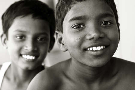 poor children: Two Indian teen boys posing to the camera  Stock Photo
