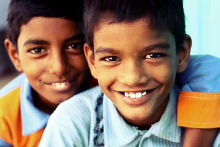 poverty india: Two teen boys looking at the camera   Stock Photo