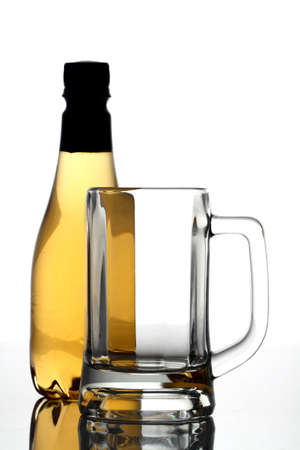 Beer bottle with crystal glass on white background   photo