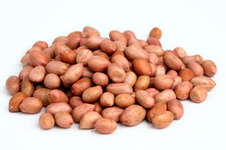 handful: Pile of peanuts with skin isolated on white