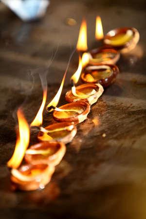 Coconut oil lamps in kapaleeswarar temple, chennai ,India   photo