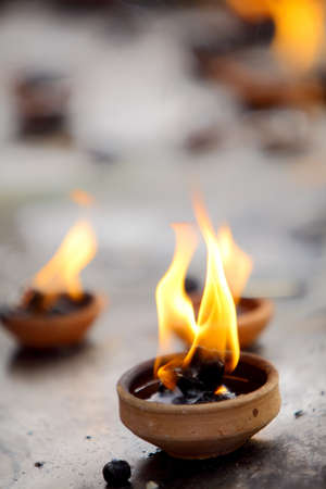 oil lamp: Coconut oil lamps in kapaleeswarar temple, chennai ,India   Stock Photo