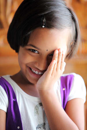 shy girl: Shying Cute Indian little girl  Stock Photo