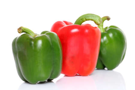 Red   Green bell pepper isolated on white Stock Photo - 13554470