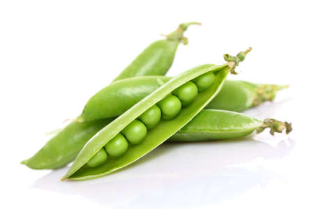 fresh green peas isolated on a white background  photo