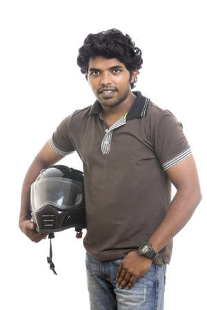 Indian young man posing with helmet to the camera   photo
