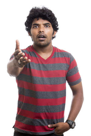 surprised Indian young man on white background   photo
