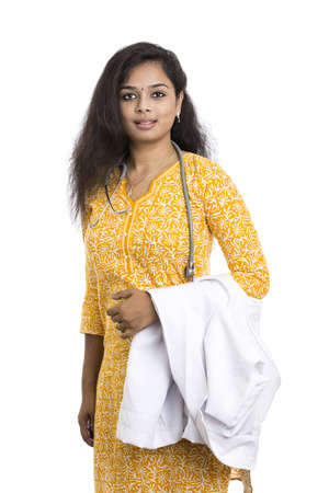 traditionally indian: A smiling young Indian Female Doctor on white background   Stock Photo
