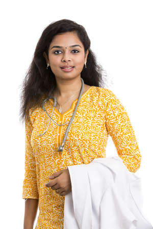paediatrician: A smiling young Indian Female Doctor on white background   Stock Photo