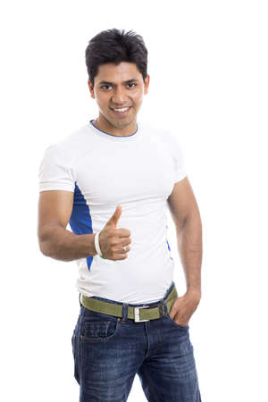thumbsup: Smart Indian young man showing thumbs up  Stock Photo