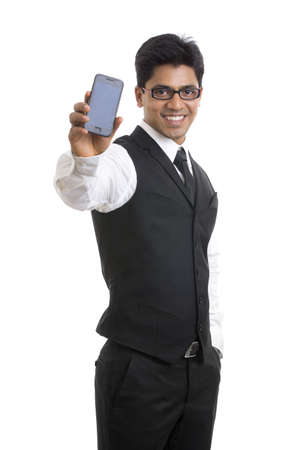 Smart Indian young businessman posing with smartphone   photo