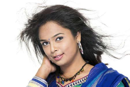 Indian Beautiful girl enjoying the wind on white   photo