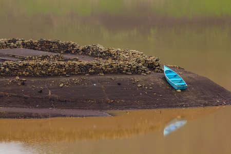 Old fishing boat in lake photo