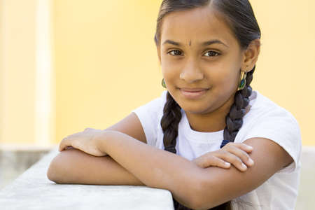 traditionally indian: cute Indian girl portrait in outdoor background. Stock Photo