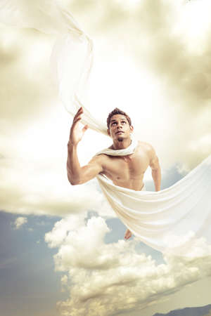 Male angel flying on sky background. photo
