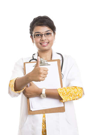 succesful: Succesful Indian young female doctor with notepad on white. Stock Photo