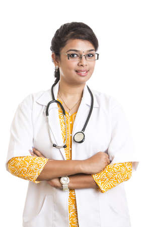 Indian young female doctor with expression on white. photo