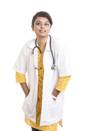Indian young female doctor on white. photo